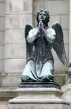 Crying angel sculpture. Old sculpture, crying angel on the stone Stock Image