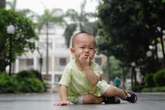 Crying asian baby. It is a cute chinese baby, he is crying in the ourdoor Royalty Free Stock Image