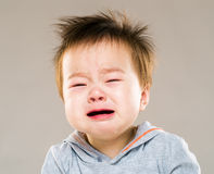 Crying asian baby boy Royalty Free Stock Photos