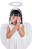 Crying Asian Chinese little girl wearing angel custome Royalty Free Stock Photography
