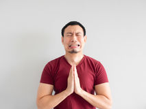 Sad man begging for forgiveness. Crying Asian man asking for forgiveness or begging the god for good fortune Stock Photography