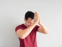 Sad man begging for forgiveness. stock images
