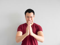 Sad man begging for forgiveness. Crying Asian man asking for forgiveness or begging the god for good fortune royalty free stock images