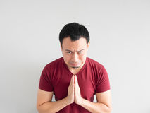 Sad man begging for forgiveness. Crying Asian man asking for forgiveness or begging the god for good fortune stock photos
