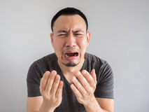 Cry asian man in black t-shirt. Crying asian man in black t-shirt stock image