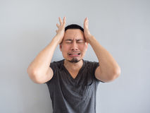 Cry asian man in black t-shirt. stock images