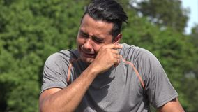 Crying Athletic Hispanic Adult Male. A handsome adult hispanic man stock video