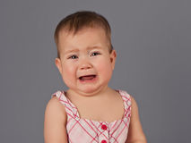 The crying babe. The little girl cries from affliction, looking at you Royalty Free Stock Photography