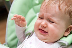 Crying Baby. Female baby crying while seated Stock Photos