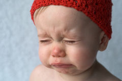 Crying Baby. Image of crying 9-month old baby Stock Photo