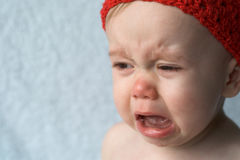 Crying Baby. Image of crying 9-month old baby Royalty Free Stock Image