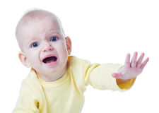 Crying baby. Cute baby girl crying on white background Royalty Free Stock Image