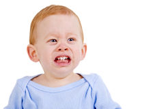 Crying baby. Sad baby boy crying with teething pain Stock Photos