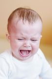 Crying baby age of 7 month Stock Image