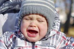 Crying baby age of 1 year outdoors Royalty Free Stock Photo