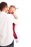 Crying baby in the arms of his father Stock Images