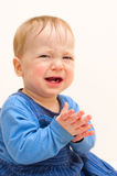 Crying baby boy. In blue wear Stock Photography