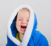 Crying baby boy. In blue bathrobe Royalty Free Stock Image