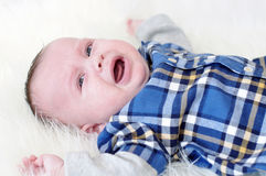 Crying baby boy age of 5 months Stock Image