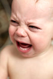 Crying baby boy in bathroom Stock Images