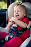 Crying baby boy in car seat Stock Photography