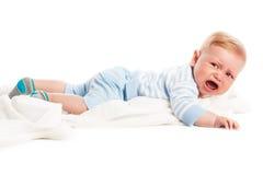 Crying baby boy. Isolated on white background. Studio shot Royalty Free Stock Photo