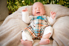 Crying Baby Boy. A baby boy crying outside. The image has a horizontal orientation Stock Photography