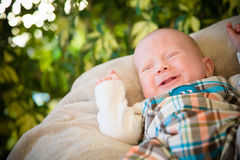 Crying Baby Boy. A baby boy crying outside. The image has a horizontal orientation and there is copy space Royalty Free Stock Photos