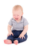Crying baby boy sitting isolated on white Royalty Free Stock Photos