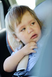 Crying baby in carseat. Crying baby girl in car seat Stock Photos
