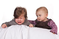 Crying baby comforted Stock Images