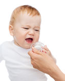 Crying baby with dummy Royalty Free Stock Image