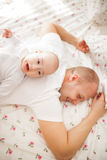 Crying baby with father Royalty Free Stock Image