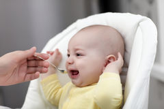 Crying baby with food Royalty Free Stock Photography