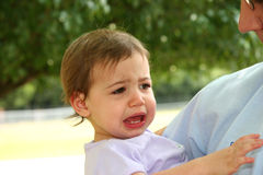 Crying Baby Girl. Close-up of baby girl crying while her daddy is holding her. Shot with Canon 20D stock photo