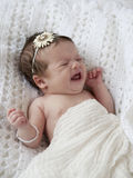 Crying Baby Girl. A beautiful little crying newborn baby girl, blur in hands due to motion Stock Photos