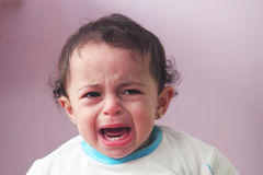 Crying angry baby girl. Arabian egyptian baby girl crying Royalty Free Stock Photography