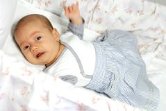 Crying baby girl in her crib Royalty Free Stock Photo