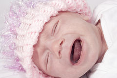 Crying baby girl. Portrait of crying four week old baby girl Royalty Free Stock Photo