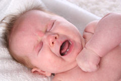 Crying Baby Girl on white towel Stock Photography