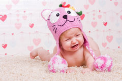 Crying baby with hat Stock Images