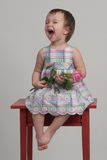 Crying baby holding flower Royalty Free Stock Photo