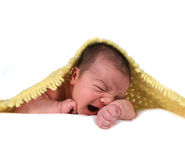 Crying Baby Infant. Infant Baby Girl With Yellow Blanket on Head Royalty Free Stock Images