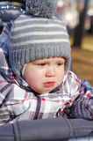 Crying baby outdoors in baby buggy Royalty Free Stock Image
