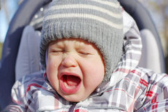 Crying baby outdoors Royalty Free Stock Images