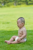 Crying baby in the park lawn Royalty Free Stock Photography