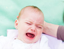 Crying baby Stock Images