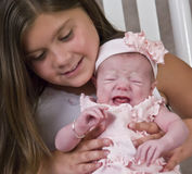 Crying baby with sister Royalty Free Stock Photos