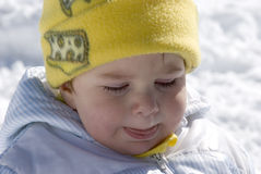 Crying baby on the snow Royalty Free Stock Image