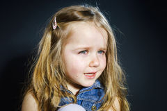 Crying blond little girl with focus on her tears Royalty Free Stock Photography